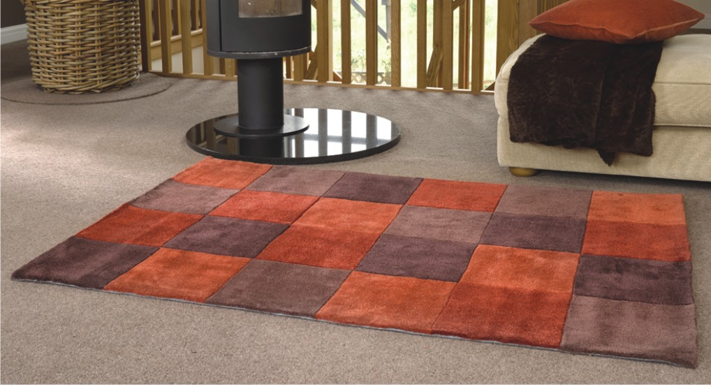 Energy infusing interiors with Orange rugs