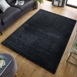 Sleek Charcoal Plain Shaggy Rug by Flair Rugs