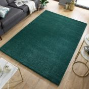 Sleek Forest Green Plain Shaggy Rug by Flair Rugs
